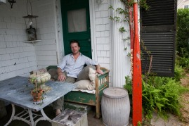 Housewares and furniture designer, John Derien, relaxes in the outdoor seating area of his home in Provincetown, MA. The home is a restored 1789 sea captain's house on Commercial Street. 06/27/10 Julia Cumes
